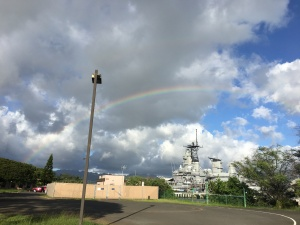 rainbow behind the USS Missouri in Hawaii